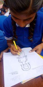 A kid learns to draw   Samridhdhi Bridge School
